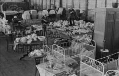 XXXIII-574-00-04-3 Voorraad bedden, aardewerk etc. ingezameld voor slachtoffers van het bombardement van 14 mei 1940.