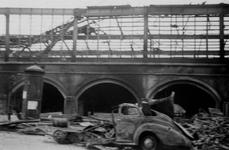 1972-73 Gezicht op de 1ste Weenastraat met het verwoeste stationsgebouw Hofplein als gevolg van het Duitse bombardement ...