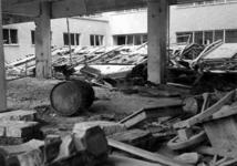 XIV-50-51-01-11 Puinresten na het bombardement van 14 mei 1940. Gezicht in het nieuwe Beursgebouw. Verwoesting . ...