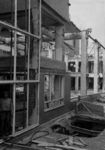 XIV-50-51-01-13 Puinresten na het bombardement van 14 mei 1940. Gezicht in het nieuwe Beursgebouw. Verwoesting . ...
